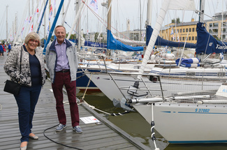 Pirkko and Pekka Koskenkylä - Swan-veneiden luoja. Pekka Koskenkylä and his wife Pirkko in front of Swan-yachts at the time of the Jubileum Regatta. Mr Koskenkylä had a clear vision of the yacht building and he managed to put his views into practice.
